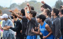 South boys cheering. In Carrolton, Sebastian Elisan(senior), Chris Wilusz(senior), Devin Schmuckal(senior), Aadi Jain(senior), Sam Gullo(senior), Andrew Wilson(senior), Ben Bergey(sophomore), and Josh Wilson(freshmen) surround the finish line. They screamed at the top of their lungs for Carmel Yonas(sophomore), and motivated her at the last 100 meters.