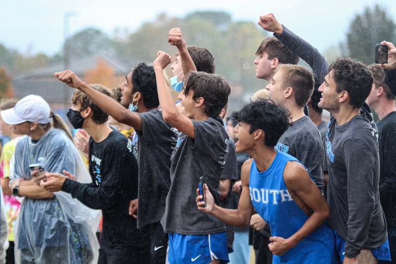 South boys cheering. In Carrolton, Sebastian Elisan(senior), Chris Wilusz(senior), Devin Schmuckal(senior), Aadi Jain(senior), Sam Gullo(senior), Andrew Wilson(senior), Ben Bergey(sophomore), and Josh Wilson(freshmen) surround the finish line. They screamed at the top of their lungs for Carmel Yonas(sophomore), and motivated her at the last 100 meters.