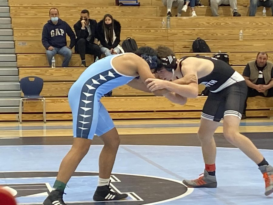 South Forsyth wrestler Finn Goss taking on Denmark wrestler Diego Gomez-Sanchez. After a quick takedown, Goss pins Sanchez in one minute and 32 seconds. This earned South Forsyth six points to the overall team score.