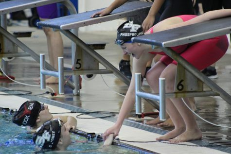 Taking home the gold. Senior Grace Drawdy and Sophomore Charlotte Tully share a moment after they beat their rival, Lambert High School, in the 4x100 yard freestyle relay. The win came unexpectedly, as the Lady War Eagles placed 3rd overall in the previous relays earlier in the morning.