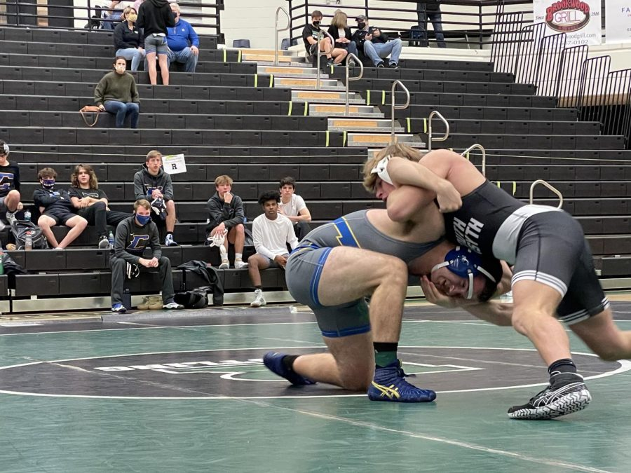 South+wrestler+Cole+Williams+standing+neutral+with+Chattahoochee+wrestler+Billy+Spradlin.+Williams+takes+down+Spradlin+twice+in+the+first+period.+In+the+end%2C+Williams+pinned+his+opponent+in+one+minute+and+55+seconds.