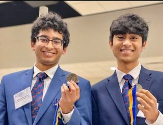 A winner's smile. Pictured are Juniors Rahav Kothuri and Abhinav Pasupuleti, posing victoriously for a photo at the 2019 State Leadership Conference. Due to the COVID-19 pandemic, the State Leadership Conference of 2020 was cancelled, students were invited to watch a live awards ceremony virtually, similar to the 2021 SLC broadcast.