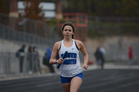 4x8 (2 laps: 4 people run) relay. Senior Ansley Rogers is sprinting down the last 100m straight as she competes in the 4x8 relay. Senior Madi Butler, Senior Katelyn Mclean, and Sophomore Emily Barnes competed with her as well.