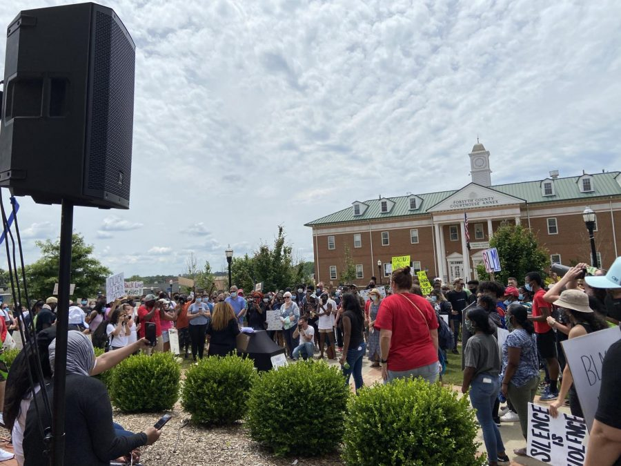 "A community comes together. During the height of the social justice protests of summer, hundreds of people gather at the Forsyth County courthouse to protest. Forsyth County residents felt it absolutely necessary to voice their anger over recent killings of Black people. ""It really helped me to feel more understood and valued in the community"" said a SFHS student who wants to remain anonymous."