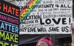 Woman advocating for LGBTQ+ rights. The Equality Act is an advancement toward further equality for LGBTQ+ people. LGBTQ+ people have been subjected to discrimination for years and the Equality Act would be a huge step for the community.