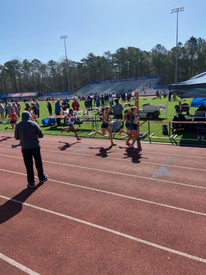 3200 (2 mile-8 laps). On Friday, March 12, freshman Isabel Yonas takes on the mile and battles through the intense competition. Yonas achieved a PR (personal record) of  11:40, and finished first with no hestitation.