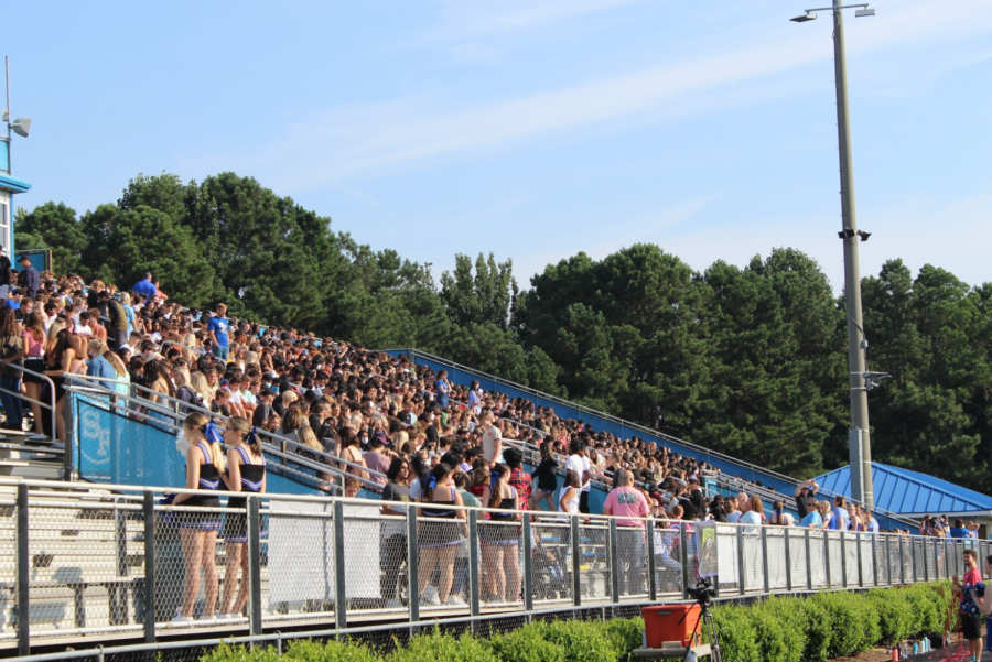 The start to a new year. Crowds of eager students await the start to a grade level scavenger hunt. Class leaders for each grade quickly ran throughout the stands to find each item for the scavenger hunt to earn the winning title.