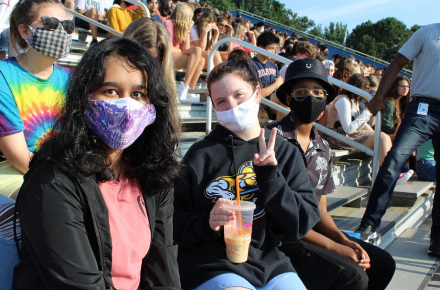A crowd of new faces. (Pictured from left to right) Aastha Mishra, Jadyn Torrow, Phylica Thompson smile for the camera as they continue to enjoy the Pep Rally on the first day of school. Students participated with others within their class to showcase their school spirit.